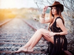 Cowgirl Sitting on the Railway Tracks