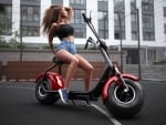 Girl with her Electric Scooter