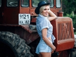 Cowgirl Posing with a Tractor