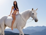 Bikini Woman on Horseback