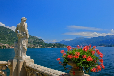 Billa del Balbianello, Lake Como, Italy - water, sky, statue, flowers, mountains