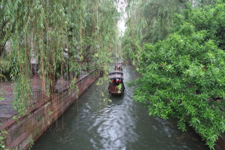 The small boat is rocking on the river - boat, China, tour, river, willow trees