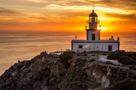 Lighthouse During Sunset - sky, sunset, sea, lighthouse, clouds, outdoor nature
