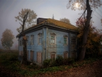 Abandoned House in Foggy Moonlit Night