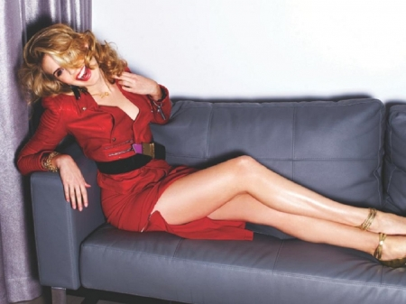 Maggie Grace in red - bracelet, red dress, necklace, legs, posing on couch, GINGERY BLONDE, black belt