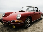 old porsche on beach