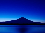 Blue volcano at nightfall