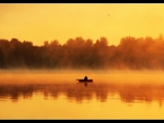 Fishing on the lake at dawn