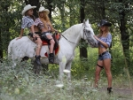 Cowgirls Ride Together . .