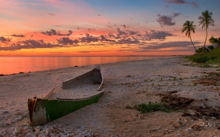 Abandoned Boat on Sandy Beach at Dusk