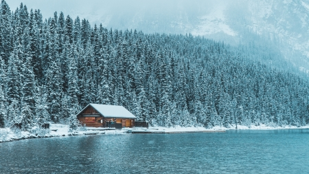 Lakeside Cabin in Winter Mountains