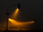 Yellow traffic lights in fog