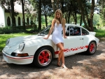 Blonde Posing with a Porsche 911 Carrera