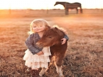 Mini Horse With Mini Cowgirl