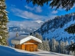 Wooden cottage in winter mountain