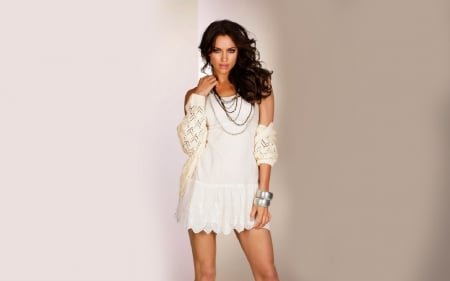 Irina Shayk - brunette, multiple layers of necklaces, large wrist bands, white lace lingerie, white lace cut out, long hair