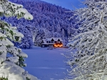 Cabin in winter mountain