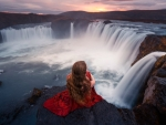 Model in Red at Godafoss Waterfall, Iceland