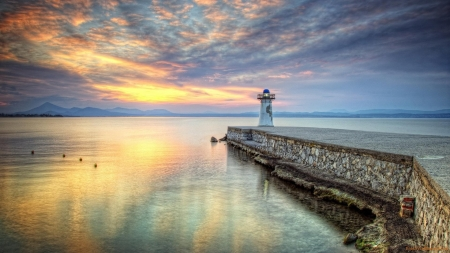 Lighthouse on a Stone Pier - shore, nature, sea, lighthouse, clouds, reflection
