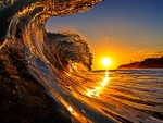 Ocean wave at sunrise
