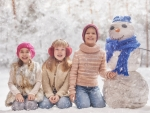 Children and a snowman