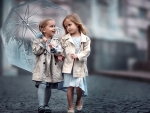 Two little girls in the rain