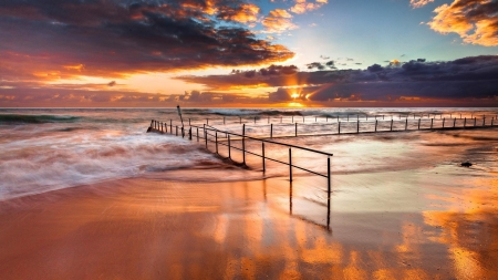 Fenced Beach in Beautiful Sunset - beach, sand, rays, ocean, nature, sunset, waves, clouds