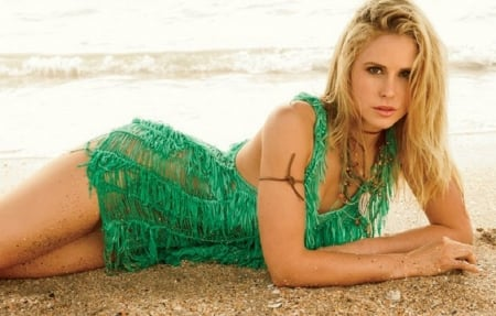 Anna Hutchison - necklaces, honey blonde, laying on wet sand, green  outfit, shredded look