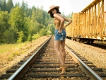 Cowgirl Walking the Rails