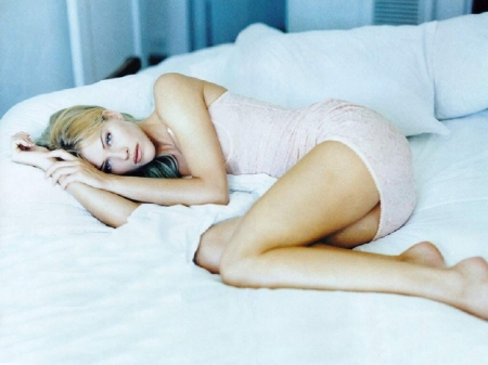 Tricia Helfer - bare feet, blonde withhighlights, posing in fetal position, on bed, mini dress, white tube style, long legs