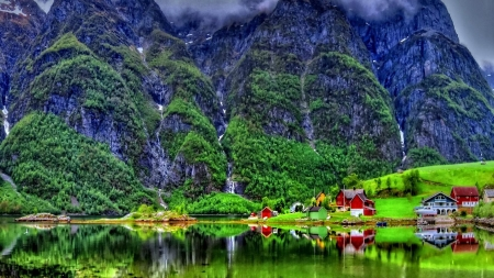 Colorful Emerald Lake - houses, greenery, emerald, cabin, mist, lake, cliffs, mountains, slope, nature, lakeshore, reflection