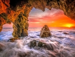 Malibu beach sea cave sunset