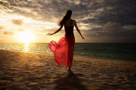 A pleasant evening by the sea - brunette, sand, red dress, walking along the beach, ocean, sheer, sunset