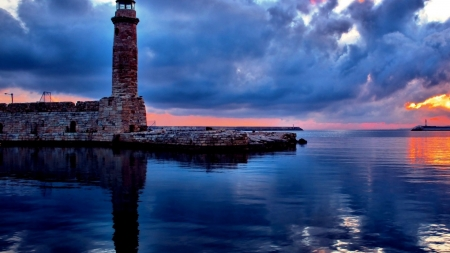 Lighthouse on the Shore - shore, nature, sunset, clouds, lighthouse, sea, weather