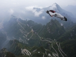 Wingsuit flyer above Tianmen Mountain