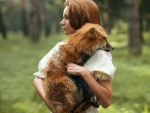 Redhead Woman And Red Fox