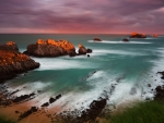 Rocky Coast of the Ocean in Cloudy at sunset