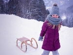 Little Girl Pulling Snow Sled