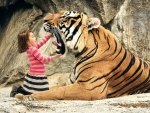 Little Girl Looking in Tigers Mouth