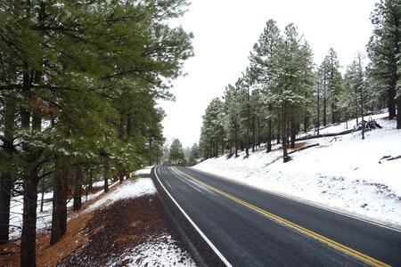 Winter Highway - sunset crater, highway, snow, arizona, crater, volcano
