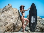 Cowgirl on Malibu Beach with Her Surfboard