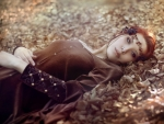 Redhead Lying On Autumn Leaves