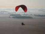 Paraplane over Misty Earth