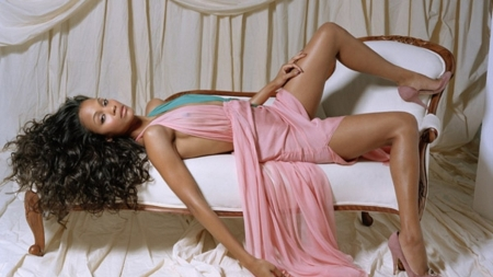 Zoe Saldana - pale pink drapes, heels, dark hair with highlights, pink dress, laying on french couch