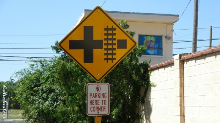 Guess What's 'Round the Corner? :D - railroad, no parking, ladybug, green, signs, grade crossing, Traffic Signals nSigns