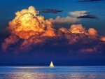 Sailboat under the cloudy sky