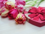 Bouquet of tulips and gift box