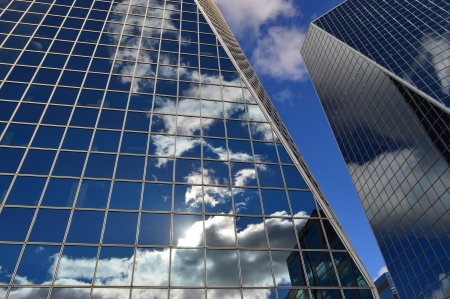 Clouded Glass - skyscraper, Erika Wittlieb, striking, sky, clouds, modern, glass, achitectures, building, unqiue point-of-view, reflections