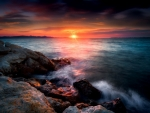 Shine from Rocky Sea Sunset