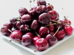 Plate of sweet cherries